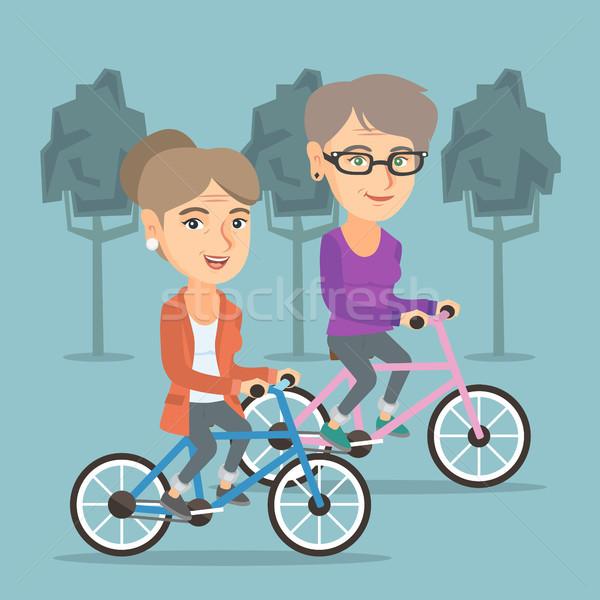 Emeryturę kobiet jazda konna rowery parku Zdjęcia stock © RAStudio