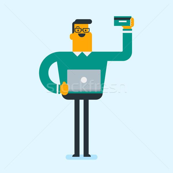 Kafkas adam dizüstü bilgisayar kullanıyorsanız online alışveriş beyaz adam ayakta Stok fotoğraf © RAStudio