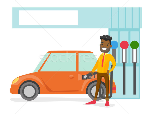 Man filling up fuel into the car at a gas station. Stock photo © RAStudio