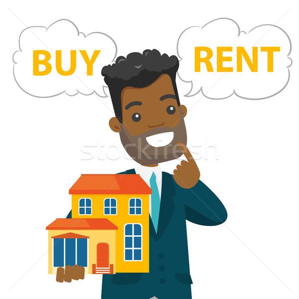 Homem pensando comprar alugar casa jovem Foto stock © RAStudio