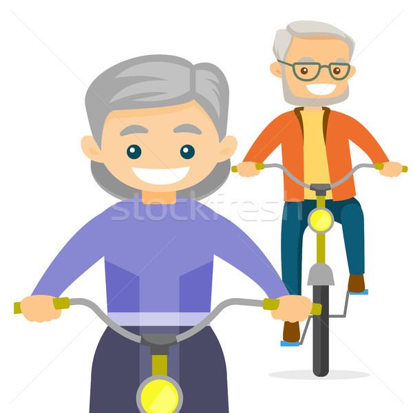 Casal velho equitação bicicletas saudável homem mulher Foto stock © RAStudio