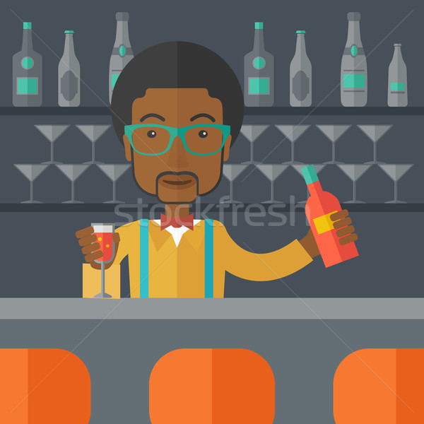 African bartender at the bar holding a drinks. Stock photo © RAStudio