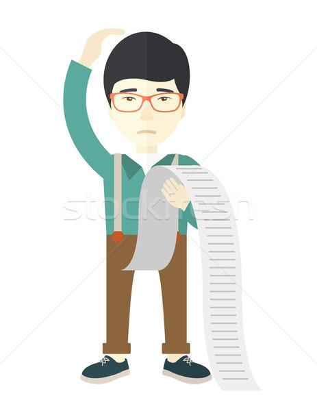 Sad japanese employee holding a list of payables. Stock photo © RAStudio