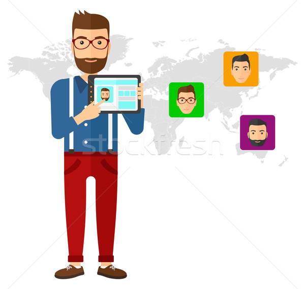 Férfi tart táblagép közösségi média forrás mögött Stock fotó © RAStudio