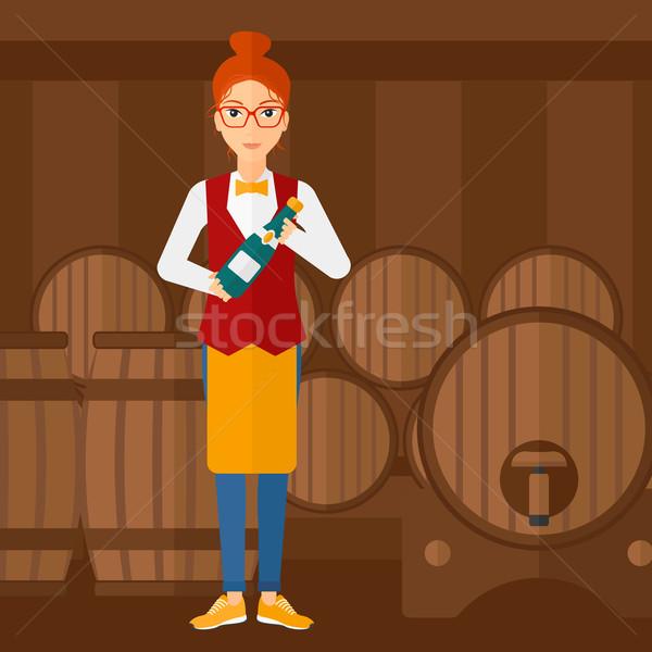 Waitress holding bottle of wine. Stock photo © RAStudio