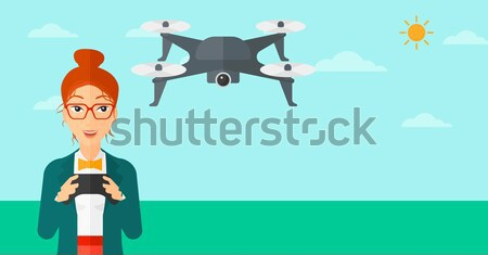Woman flying drone. Stock photo © RAStudio