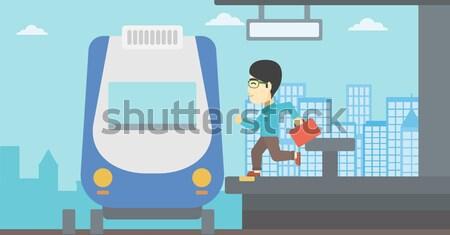 Férfi fut vonat ázsiai aktatáska vágány Stock fotó © RAStudio