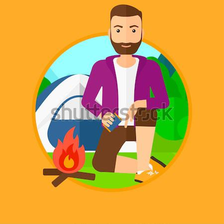 Woman kindling campfire vector illustration. Stock photo © RAStudio