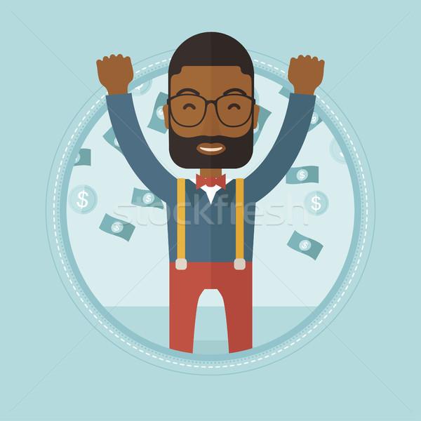 Happy busiessman under money rain. Stock photo © RAStudio