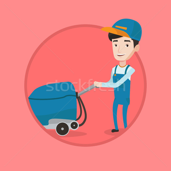 Male worker cleaning store floor with machine. Stock photo © RAStudio