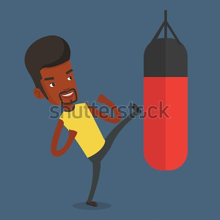 Man exercising with punching bag. Stock photo © RAStudio