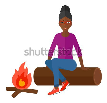 Woman sitting on log near campfire in the camping. Stock photo © RAStudio