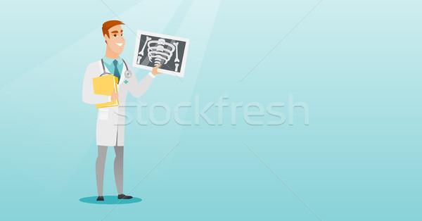 Doctor examining a radiograph vector illustration. Stock photo © RAStudio