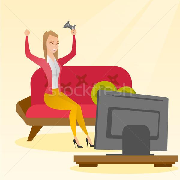 Woman playing a video game vector illustration. Stock photo © RAStudio