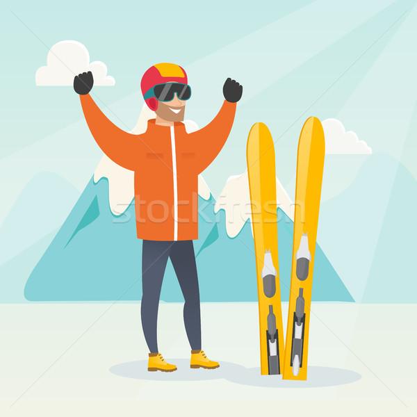 молодые кавказский лыжник Постоянный поднятыми руками гор Сток-фото © RAStudio