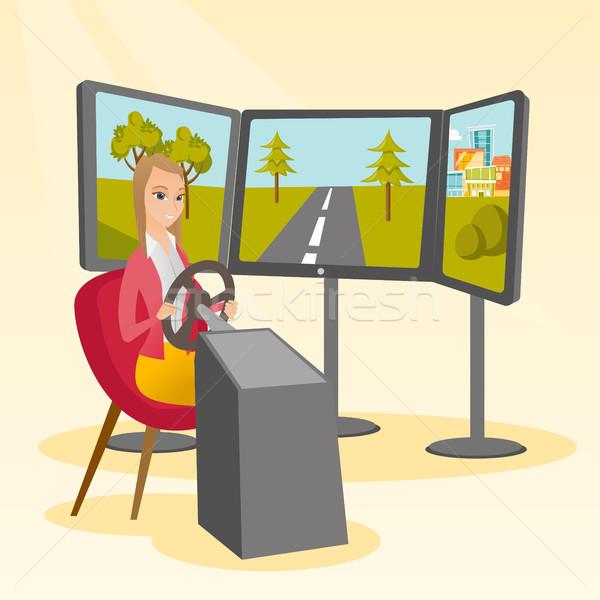 Fiatal nő játszik videojáték számítógépes játékok kerék izgatott Stock fotó © RAStudio