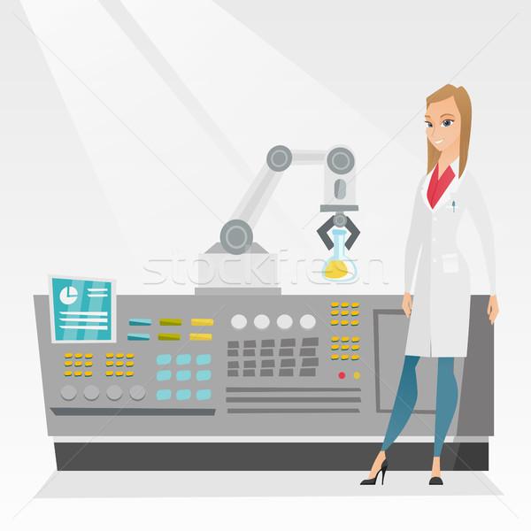 Scientist and robotic arm conducting experiments. Stock photo © RAStudio