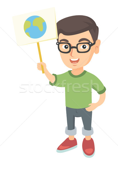 Caucasian boy holding a placard with planet. Stock photo © RAStudio