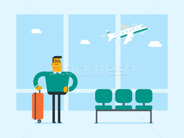 Caucasian man standing at airport with suitcase. Stock photo © RAStudio