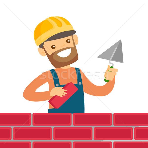 кавказский белый каменщик здании кирпичная стена молодые Сток-фото © RAStudio