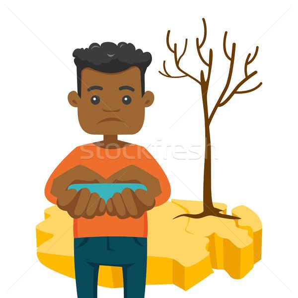 Homem água secar terra mãos Foto stock © RAStudio