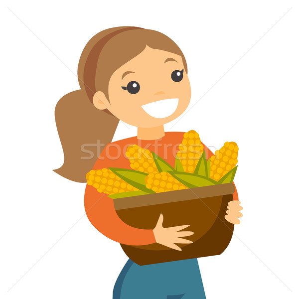 A white happy woman with a basket of corncobs. Stock photo © RAStudio