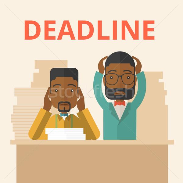 Two stressed african-american employees.  Stock photo © RAStudio