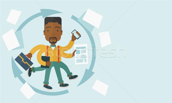 Black guy with multitasking job. Stock photo © RAStudio