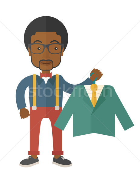 Happy young african man chooses a perfect clothe. Stock photo © RAStudio