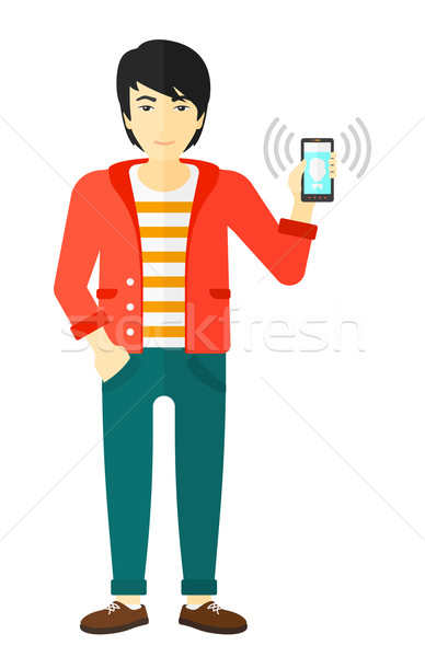 Man holding ringing telephone. Stock photo © RAStudio