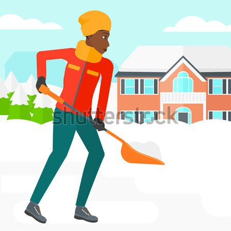Woman shoveling and removing snow. Stock photo © RAStudio