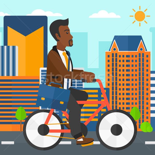 Uomo ciclismo lavoro valigetta città vettore Foto d'archivio © RAStudio