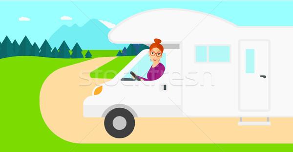 Woman driving motor home. Stock photo © RAStudio