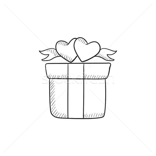 Gift box with hearts sketch icon. Stock photo © RAStudio