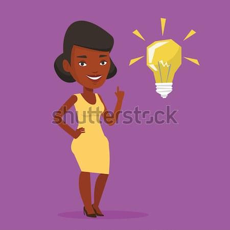 Student pointing at idea bulb vector illustration Stock photo © RAStudio
