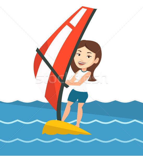 Stock photo: Young woman windsurfing in the sea.