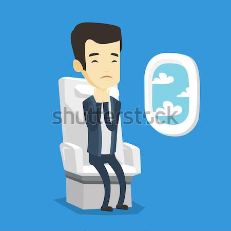 African-american man suffering from fear of flying Stock photo © RAStudio
