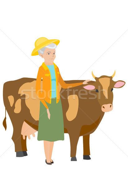 Senior farmer standing with crossed arms near cow. Stock photo © RAStudio