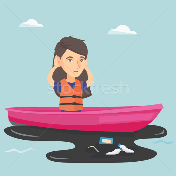 Young woman floating on a boat in polluted water. Stock photo © RAStudio