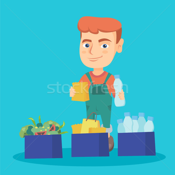 Boy separating plastic, paper and food waste. Stock photo © RAStudio