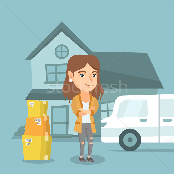 Young caucasian woman moving to a new house. Stock photo © RAStudio