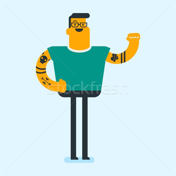 Caucasian white man with tattoo showing biceps. Stock photo © RAStudio