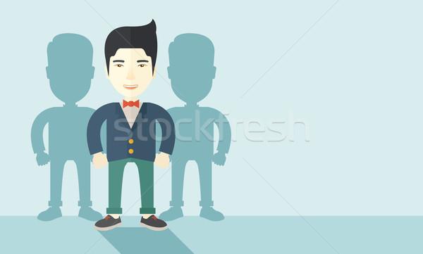 Japanese businessman standing straight with his shadows. Stock photo © RAStudio