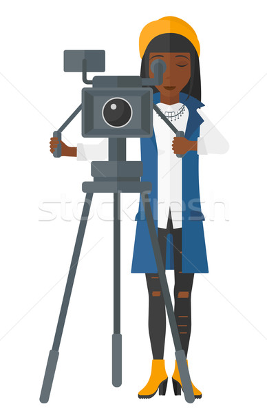 Camerawoman with movie camera. Stock photo © RAStudio