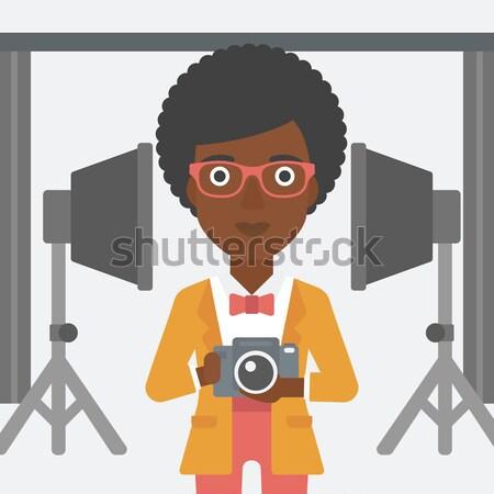 Souriant photographe caméra homme photo Photo stock © RAStudio