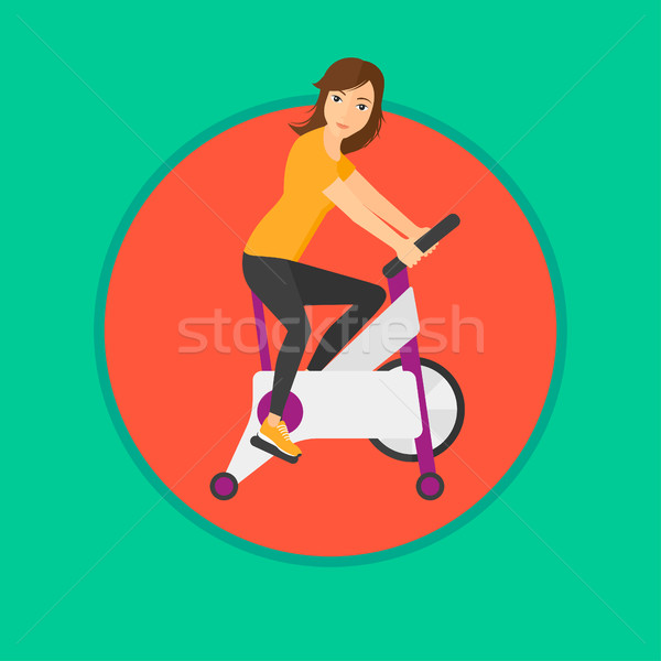 Nő lovaglás mozdulatlan bicikli sportos testmozgás Stock fotó © RAStudio