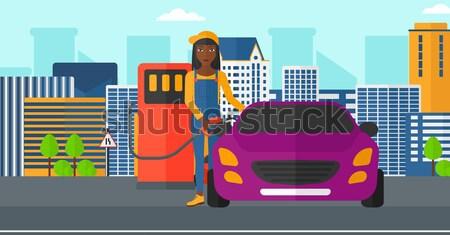 Worker filling up fuel into car. Stock photo © RAStudio