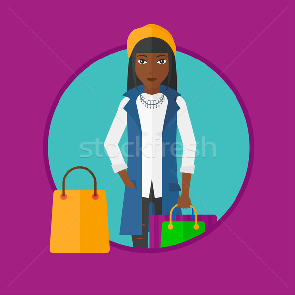 Woman with shopping bags vector illustration. Stock photo © RAStudio
