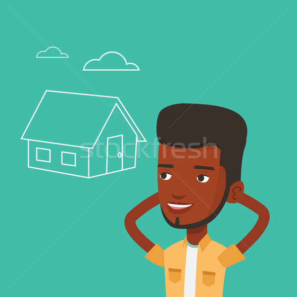 Man dreaming about buying new house. Stock photo © RAStudio