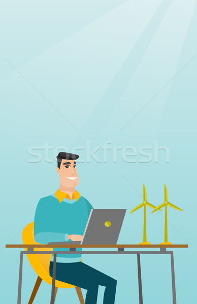 Man working with model of wind turbines. Stock photo © RAStudio